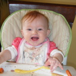 Willow experiments with food at 6 months and loves it!