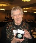 Dr. Naylor receives coin for her protection, promotion and support of breastfeeding at US Breastfeeding Committee meeting in August of 2010.