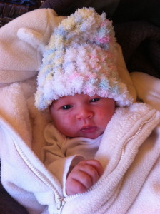 Baby Iris sports one of Storey's darling hats knitted during a birth.