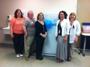 Columbia St. Mary's Mother Baby nurses and lactation professionals pose in front of the depot freezer