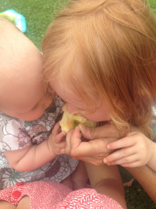 Willow and Iris share an apple.